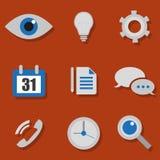 Icone di tecnologia su un fondo arancio Fotografie Stock Libere da Diritti