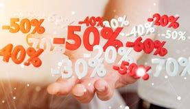 Icone di vendite della tenuta dell'uomo d'affari nella sua rappresentazione della mano 3D Fotografia Stock