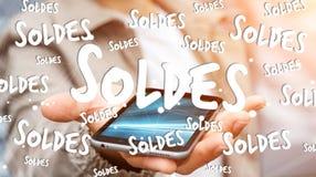 Icone di vendite della tenuta dell'uomo d'affari sopra la sua rappresentazione del telefono 3D Fotografie Stock