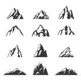 Icone di vettore della montagna messe Insieme degli elementi della siluetta della montagna Fotografie Stock Libere da Diritti