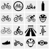Icone di vettore di ciclismo messe su gray. Fotografia Stock