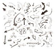 Icone disegnate a mano delle frecce di vettore messe su bianco Immagini Stock