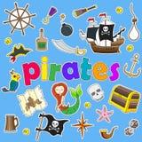 Icone messe sull'argomento di pirateria e toppe marittime e dipinte delle icone su un fondo blu Fotografia Stock Libera da Diritti