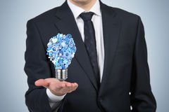 Icone nella lampadina della forma Immagini Stock