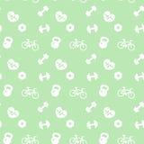 Icone senza cuciture di forma fisica del modello su verde Fotografia Stock
