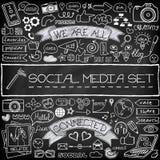 Icone sociali di media di scarabocchio messe con la lavagna Fotografia Stock