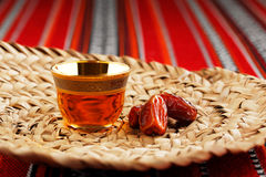 Iconic Abrian fabric with Arabic tea and dates symbolise Arabian hospitality Royalty Free Stock Photos