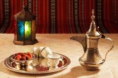 Free Iconic Abrian Fabric Tea And Dates Symbolise Arabian Hospitality Stock Photos - 47775693