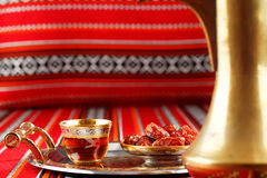 Iconic Abrian fabric tea and dates symbolise Arabian hospitality. Iconic Abrian fabric is graced with sybbols of Arabia, in particular Arabic tea and dates, they Royalty Free Stock Image