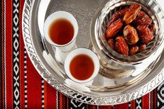 Iconic Abrian fabric tea and dates symbolise Arabian hospitality. Iconic Abrian fabric is graced with sybbols of Arabia, in particular Arabic tea and dates, they Royalty Free Stock Photos