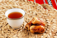 Iconic Abrian fabric tea and dates symbolise Arabian hospitality. Iconic Abrian fabric is graced with sybbols of Arabia, in particular Arabic tea and dates, they Royalty Free Stock Images