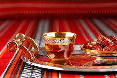 Iconic Abrian fabric tea and dates symbolise Arabian hospitality. Iconic Abrian fabric is graced with sybbols of Arabia, in particular Arabic tea and dates, they Royalty Free Stock Photo
