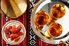 Iconic Abrian fabric tea and dates symbolise Arabian hospitality. Iconic Abrian fabric is graced with sybbols of Arabia, in particular Arabic tea and dates, they Stock Photography