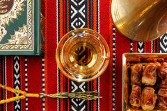 Iconic Abrian fabric tea and dates symbolise Arabian hospitality. Iconic Abrian fabric is graced with sybbols of Arabia, in particular Arabic tea and dates, they Stock Image