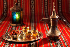 Iconic Abrian fabric tea and dates symbolise Arabian hospitality. Iconic Abrian fabric is graced with sybbols of Arabia, in particular Arabic tea and dates, they Stock Images