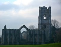 Iconic Ancient Abbey in North Yorkshire. Fountains Abbey preserved ruins of Cistercian Monastery in North Yorkshire. World heritage Site near Ripon stock photography
