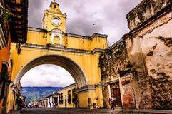 Iconic arch, Antigua, Guatemala. Calle del Arco, Antigua, Guatemala - Nov 19, 2014: Iconic arch in popular tourist street in Spanish colonial town of Antigua Royalty Free Stock Photography