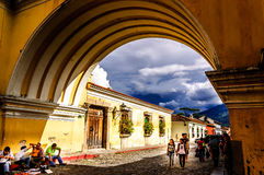Iconic arch, Antigua, Guatemala. Calle del Arco, Antigua, Guatemala - Oct 11, 2014: Iconic arch in popular tourist street in Spanish colonial town of Antigua Royalty Free Stock Photography