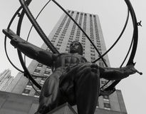 The Iconic Atlas Statue with the Rockefeller Center in the background. The world famous Atlas sculpture viewed from below with the Rockefeller Center in the Stock Images