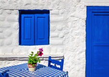 Iconic blue table with wooden chairs , Greece Stock Image