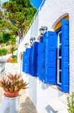 Iconic blue wooden shutters in Greece Royalty Free Stock Images