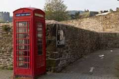 Iconic British red telephone box in Conwy, Wales Royalty Free Stock Images