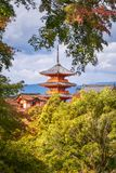 Iconic buildings of the Kiyomizu-dera Buddhist Temple -view through autumn trees. Iconic buildings of the Kiyomizu-dera Buddhist Temple with the main Pagoda royalty free stock images
