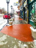 Iconic Cherry Street with Peace of Mind bookstore on snowy day in Tulsa Oklahoma USA ‎December ‎5 ‎2013 stock photo