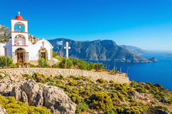 Iconic church with red roof on cliff, Greece Royalty Free Stock Photography