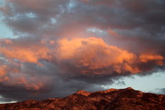 Iconic Colorful orange and pink sunset over red mountains in Tucson arizona Royalty Free Stock Image