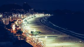 Iconic Copacabana beach, viewed from above, Rio de Janeiro, Brazil. Long exposure at night of iconic Copacabana beach, viewed from above, Rio de Janeiro, Brazil royalty free stock photos