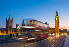 Iconic Double Decker bus with Big Ben and Parliament at blue hour, London, UK Stock Photo