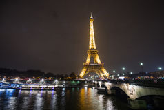 Iconic Eiffel Tower Illuminated at night. Eiffel Tower is Illuminated each evening which is a magnet for tourists from far and wide to view this iconic building Royalty Free Stock Images