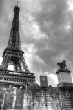 Iconic Eiffel Tower in Paris, France. Dramatic black and white image of the iconic Eiffel Tower in Paris, France. The image is taken from a boat on the Seine Stock Photography