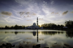 Iconic floating mosque at Terengganu, Malaysia with reflection on the lake. Stock Photo