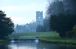 Iconic Fountains Abbey North Yorkshire. Fountains Abbey preserved ruins of Cistercian Monastery and beautiful gardens in North Yorkshire. World heritage Site stock image