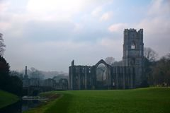 Iconic Fountains Abbey In North Yorkshire. Fountains Abbey preserved ruins of Cistercian Monastery in North Yorkshire. World heritage Site near Ripon stock photography