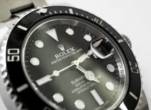 Close-up view of a well-known, Swiss manufactured men`s automatic diving watch seen on a jewellers table. royalty free stock photos