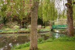 The iconic green Japanese bridge in Monet`s garden at Giverny in royalty free stock image