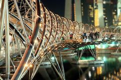 The iconic Helix Bridge. Photo of the iconic Helix Bridge connecting Marina Bay Promenade to the Marina Bay Sands Integrated Resort in Singapore Stock Photo