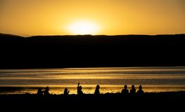 Iconic high contrast sunset in Atacama lake. Iconic high contrast silhouettes enjoy sunset in Atacama lake, Chile royalty free stock photography