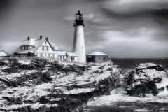 Portland Maine Headlight Winter Scene black and white. The iconic and historic Portland Maine Headlight Lighthouse after a winter snow on a sunny day in black stock photo