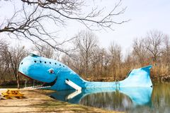 Iconic huge Blue Whale roadside attraction by swimming hole on Route 66 in Oklahoma on a winter day stock photography