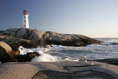 Peggys Cove Lighthouse and Waves stock photo
