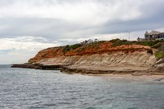 The iconic limestone cliff faces of the Port Noarlunga Beach Sou. Th Australia on 23rd August 2018 royalty free stock photo