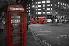 Iconic London. London in red, white and black. Iconic London in one photograph, with telephone booth and double decker bus Stock Photos