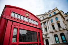Iconic London red phone box. With Listed building in background, London Stock Photos