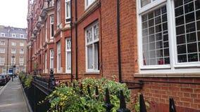 Iconic London viktorianskt herrgårdkvarter Arkivbild