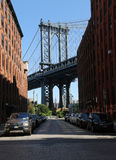 Iconic Manhattan Bridge and Empire State Building view from Washington Street in Brooklyn Royalty Free Stock Images