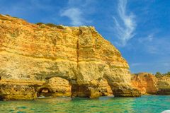 Marinha Beach Natual Arch. The iconic natural arch of Praia da Marinha in Algarve, Portugal, Europe view from popular boat cave tour along Algarve coast. Marinha Stock Images